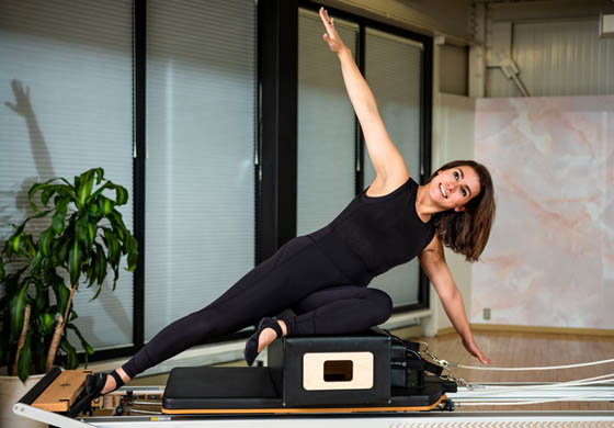 Nina, one of our Pilates instructors, on reformer in the Pilates Studio