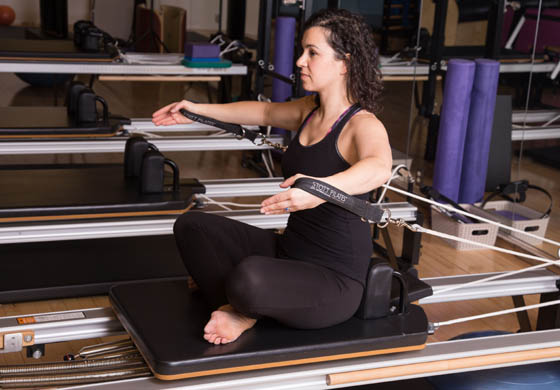 Stephanie Schreiber, Director of Pilates & Yoga, on reformer in the Pilates Studio