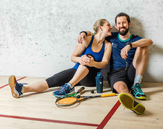 Member and his wife on the squash courts