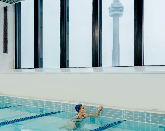 Member in our Pool, with CN Tower in the background