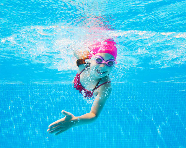 Girl swimming underwater in the Pool