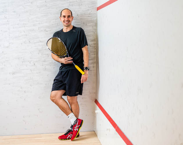 Matt Serediak, one of our squash pros, standing on a Toronto Athletic Club squash court